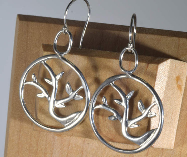 The tree of life 2 drop earrings are hand crafted in Portland, Maine.  The earrings weigh 4.7 grams and measure 2 inches in length x 1 wide.  The earrings are inspired by a cherry tree outside my store front.