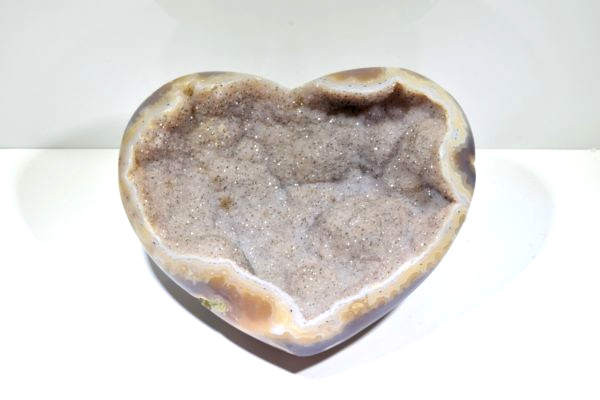 The druzy agate heart is a grey background with black spots.  The specimen is heart in shape measuring approximately 5 x 4.25 x 2.25 inches.  The heart is polished around the edges and on the base, so that you can see the pattern of the agate.  The heart weighs 521.6 grams.