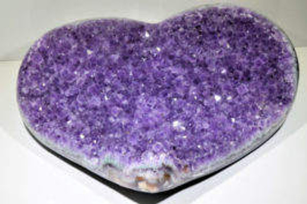 The amethyst heart druzy is carved from a geode.  The heart is polished on edges and the base as well.  The crystals are well formed and medium in size.  The color is a medium purple.  The specimen comes from Uruguay.
