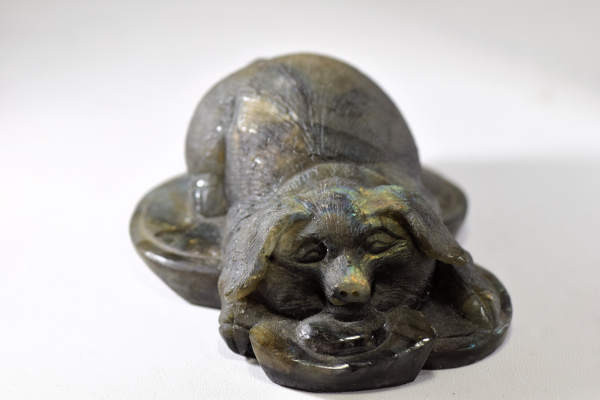 The labradorite pig is a very cunning creature expertly carved.  The pig has a frosted finish with wonderful color and measures 4 x 3.5 x 2 inches and weighs 395.5 grams.  The labradorite is from Madagascar.