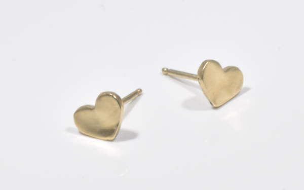The 14 K yellow gold tiny heart studs are hand crafted in Portland, Maine.   The studs are a polished heart measuring 6.2 mm.  x 8.2 mm. x 1 mm. and weigh 1.8 grams.
