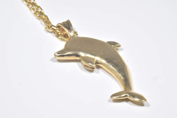 The 14 K yellow gold dolphin pendant, is hand crafted in Portland, Maine.  The pendant weighs 9.6 grams and measures 1 7/8 x 1/8 x 1 inches.  the dolphin has a polished finish and the chain is sold separately.  the pendant is on a gold link style 16 inch chain.