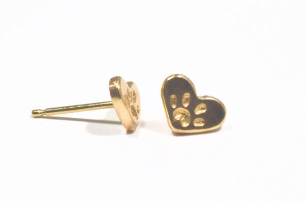 The gold Hearts have a paw print on the front.  The earrings are hand crafted in Portland, Maine.  The hearts weigh 1.2 grams and measure 6.2 mm. x 8.2 mm. x 1 mm.  The earrings are 14 k yellow gold.  A portion of the profits is donated to the Animal Refuge League of greater Portland, Maine area.