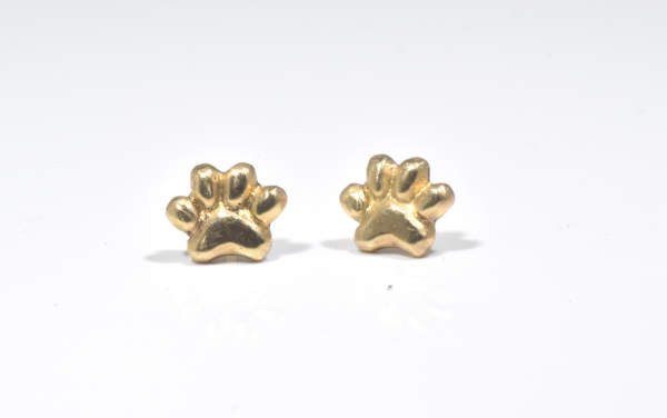 The gold paw print studs are hand crafted in Portland, Maine.  The paw is a 2 dimensional stud and measures 6.6 mm. x 8 mm. and weighs 1.7 grams.  The studs were designed to remind me of my special pups.  A portion of the profits will be donated to the Animal Refuge League of greater Portland, Maine.