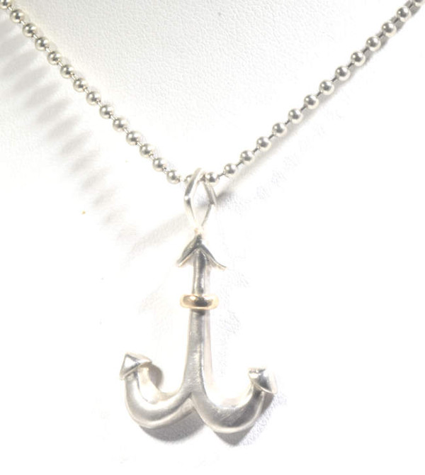 The anchor pendant is hand crafted in Portland, Maine.  The anchor is sterling silver and 14 K yellow gold.  the pendant is brushed and polished.  The anchor measures 1.25 x .75 x .5 inches and weighs 3.2 grams.  The pendant fits a 3 mm. chain.