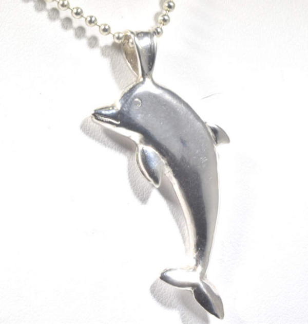 The sterling silver dolphin pendant is hand crafted in Portland, Maine.  The dolphin is 2 dimensional and is solid, weighing 7.8 grams.  the pendant measures 1.75 x 1 x .4 inches.  The pendant fits a 4 mm. chain which is not included but available upon request.