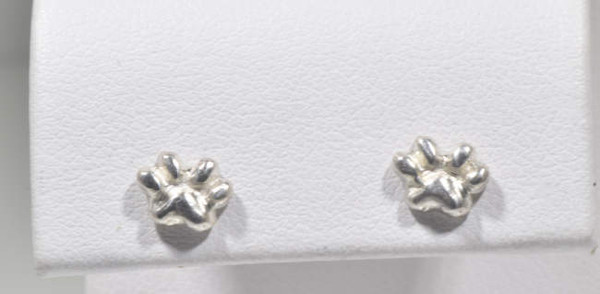 The small sterling silver dog paw studs are hand crafted in Portland, Maine.  The studs a part of the Pawz series which a portion of the profits are donated to the Animal Refuge League of Portland, Maine.  The studs are solid and weigh 1.1 grams.  The pawz measure 5.2 mm. x 7 mm.
