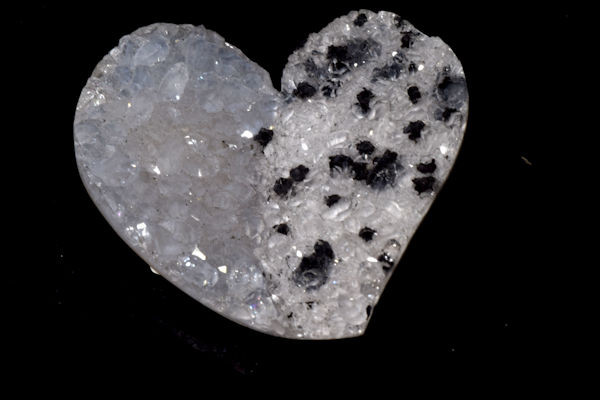 The hand carved black and white druzy heart is a one of a kind.  The druzy has a white side with black spots and a slightly clear/grey side.  The heart measures 40 mm. x 43 mm. x 10 mm.  This is a very unique piece.