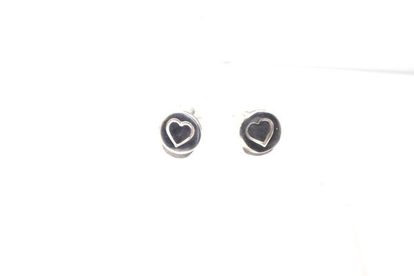 The sterling silver disc heart studs are hand crafted in Portland, Maine.  The disc is 8 mm. x 1 mm. with a heart on the center.  The earrings weigh 1.3 grams.