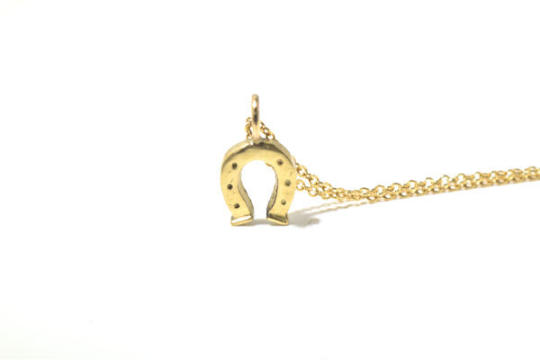 The gold horseshoe pendant is hand crafted in Portland, Maine.  The pendant is 14 k yellow gold and weighs 1.0 grams.  The horseshoe measures 13.5 mm. x 7.5 mm. x 1.5 mm. and has a polished finish.  The pendant is solid.  The chain is sold separately.  It is available upon request, measuring 1.3 mm. and a cable style 16 inches in length. The chain cost is $248.00.  A portion of the profits will be donated to the Animal Refuge League of greater Portland, Maine.