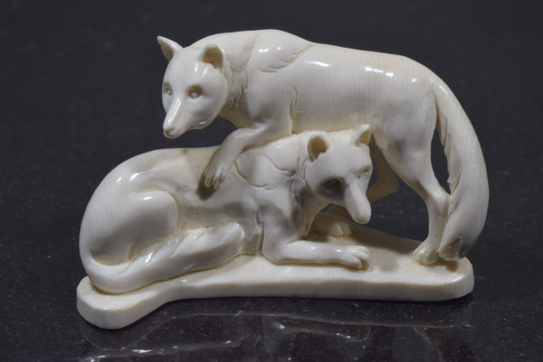 The fossilized ivory wolves are hand carved in Indonesia.  The ivory is fossilized mammoth tusk.  The piece weighs 30.5 grams and measures 2 1/3 x 1 1/4 inches.  For international shipping there will be a 2% handling fee added for shipping insurance.  This is to ensure that your package arrives to you safely.