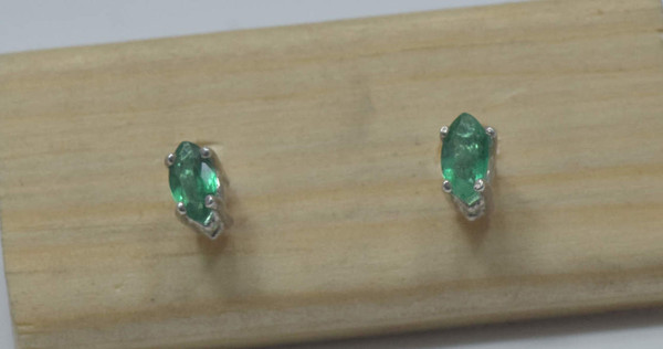 The emerald studs are marquis in shape and have a total weight of .14 carats.  The stones measure 5 mm. x 3 mm., and are set in sterling silver prong settings.  The emeralds are a good green color and they weigh .8 grams.  Emerald is the birthstone for May.