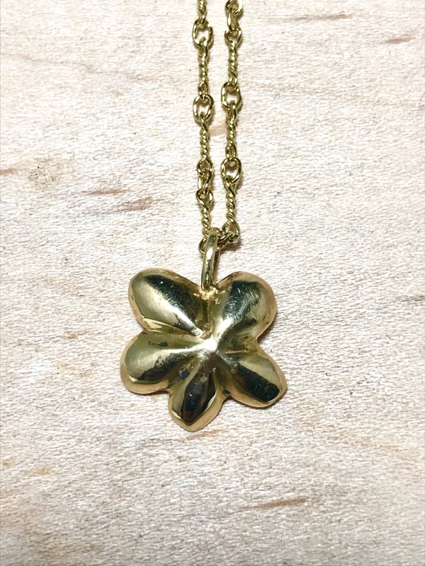 The medium gold diamond flower pendant is handcrafted in Portland, Maine.  The pendant is 14K yellow gold and measures 14.5 mm. x 15.7 mm. 4 mm.  The pendant is solid and has a polished and brushed finish.  There is a 1.8 mm. round diamond set in the center.  The pendant weighs 2.5 grams.  The chain is a 18 inch twisted figaro chain that is supplied with the pendant.  If you require a different length or chain please contact us and we can assist with the correct chain. o ensure that your package arrives to you safely, there will be a 2% handling fee for additional insurance on international shipping.