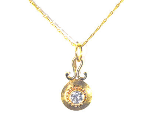 The 22 k diamond beaded pendant is hand crafted in Portland, Maine. The pendant is a a .37 carat round brilliant cut diamond with a color of I and a clarity of I 1. The stone is set in a 22 k yellow gold bezel with beads around it and a drop style pendant of 18 K measuring 1 x .5 inches and weighs 2.4 grams