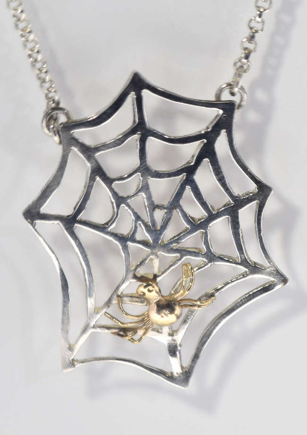 The single cobweb and spider is hand crafted in Portland, Maine.  The necklace is sterling silver and 14 K yellow gold.  The necklace is 17.25 inches and weighs 7.9 grams.  This necklace is a great addition to any Goth wardrobe.