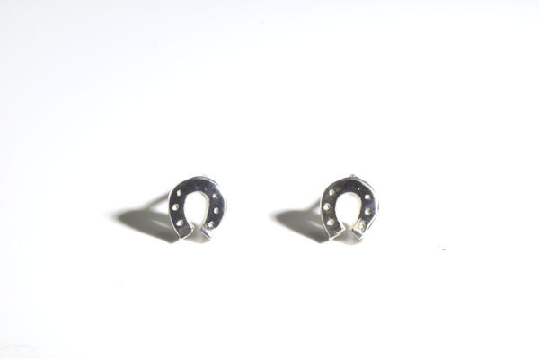 The tiny sterling silver horse shoe earrings are hand crafted in Portland, Maine.  The stud earrings are solid and weigh 1.5 grams and measure 1/4 x 1/16 inches and have a polished finish.