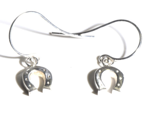 The silver horse shoe dangle drop earrings are hand crafted in Portland, Maine.  the earrings have a movement at the hook.  The earrings measure 1 x 3/8 x 1/16 inches.  The earrings are solid and weigh 1.9 grams.