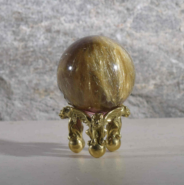 The rutilated quartz sphere is  very nice heavily rutilated piece.  The piece is 2 inches in diameter and is from Brazil.