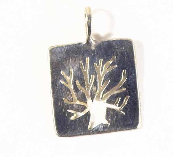 The silver square tree of life pendant is hand crafted in Portland, Maine. The pendant measures 16 mm. x 15 mm. x 1 mm. and weighs 1.7 grams. The tree is cut out in the center and has a polished finish. The chain is sold separately