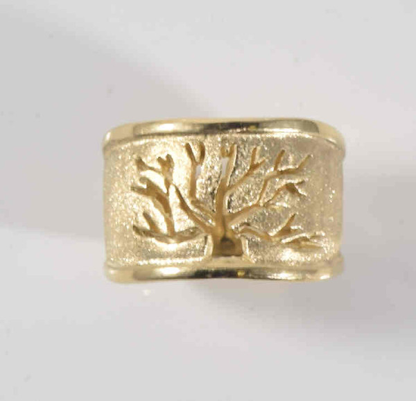 The piece is a 14 k yellow gold tree of life ring. The ring is handcrafted in Portland, Maine, with a brushed and polished finish and has a cut out of the tree of life. The ring measures 12 mm. at the top and tapers to 6.5 mm.at the base. The tree of life ring is 1.5 mm. thick and weighs 10.6 grams. The ring is a size 5.75 and can be sized upon request.
