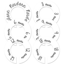White baby closet dividers for a gender neutral baby shower gift.