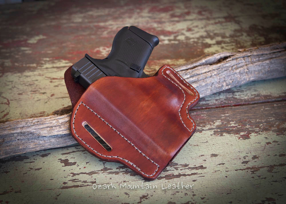 Custom leather gun holster for small to large frame guns.