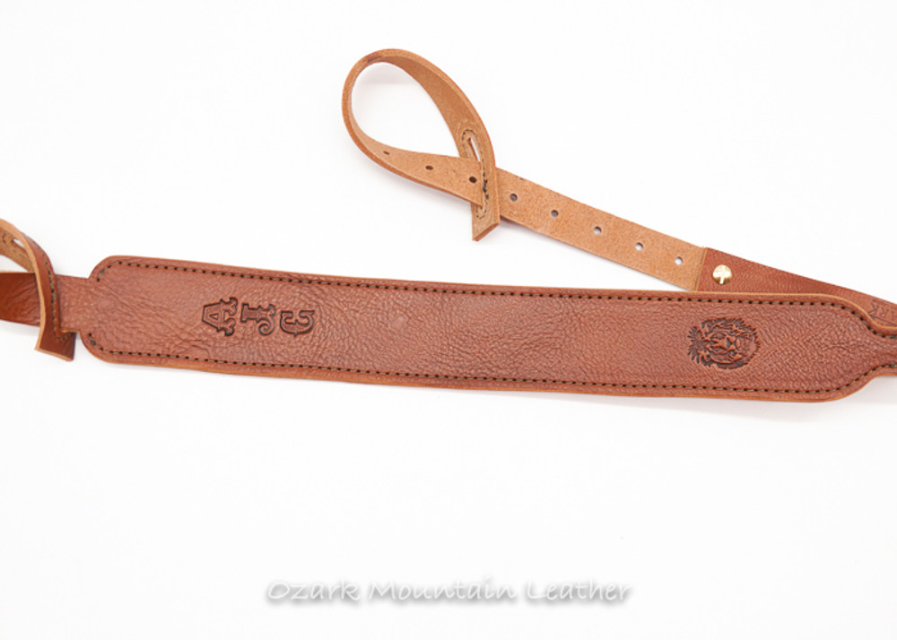 Custom leather shotgun sling for a gun without swivels.  Leather rifle sling personalized with name or initials.