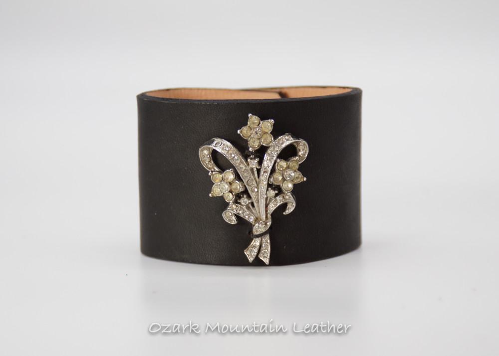 Bouquet shapped vintage rhinestones on black leather cuff