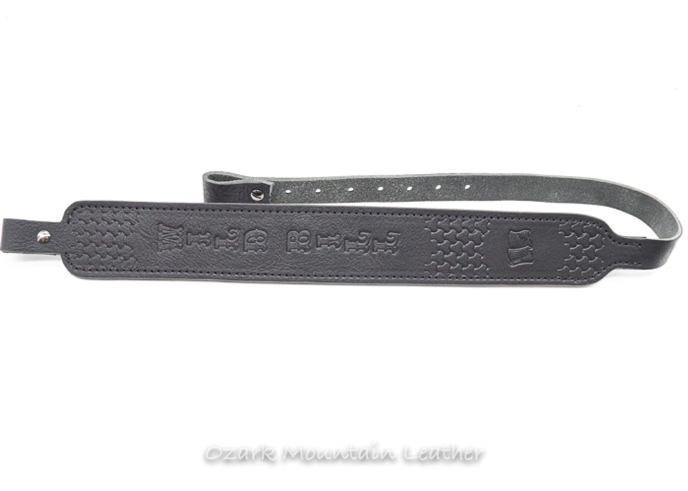 Custom black leather hand tooled padded leather rifle sling made in the USA.  Custom stamps available.  Custom name available.  Slim style gun sling in leather.  Shown in Black