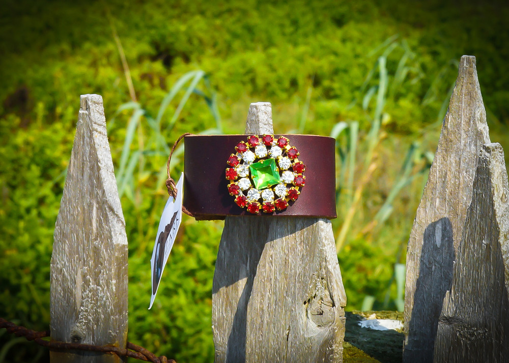 Red and green vintage rhinestones on red leather cuff
