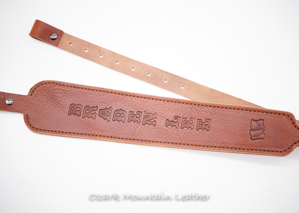 Custom leather rifle sling in brown.  Can be personalized with name or initials and also a custom stamp option. Cobra shape, cobra style rifle sling.