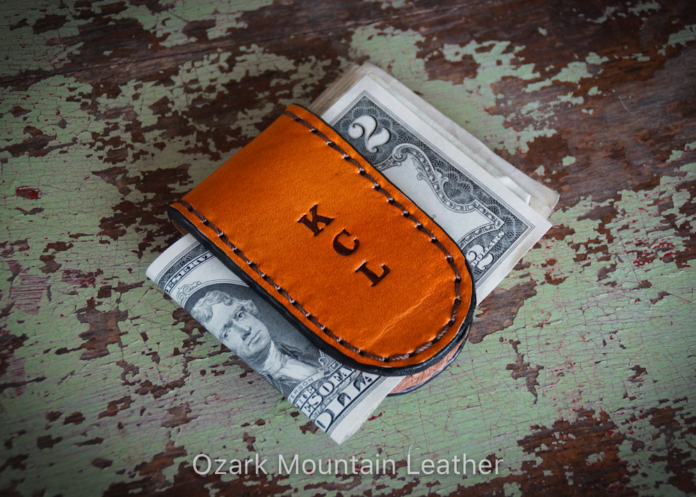 Custom made leather magnetic money clip with personalization.  Made with strong earth magnet.