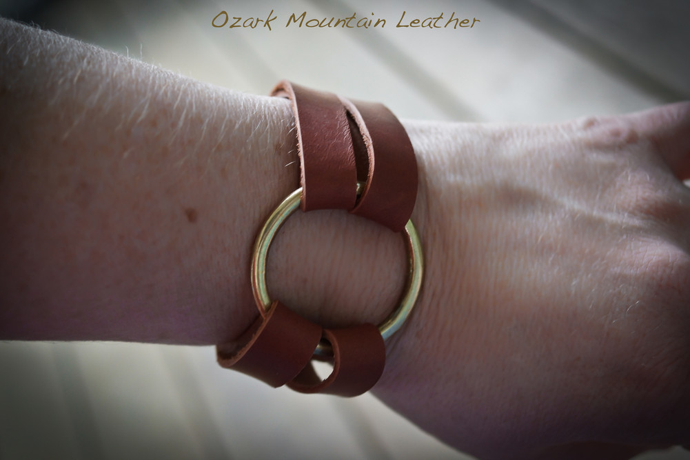 Brass O ring Horween Leather bracelet.  Adjustable so fits almost any wrist.