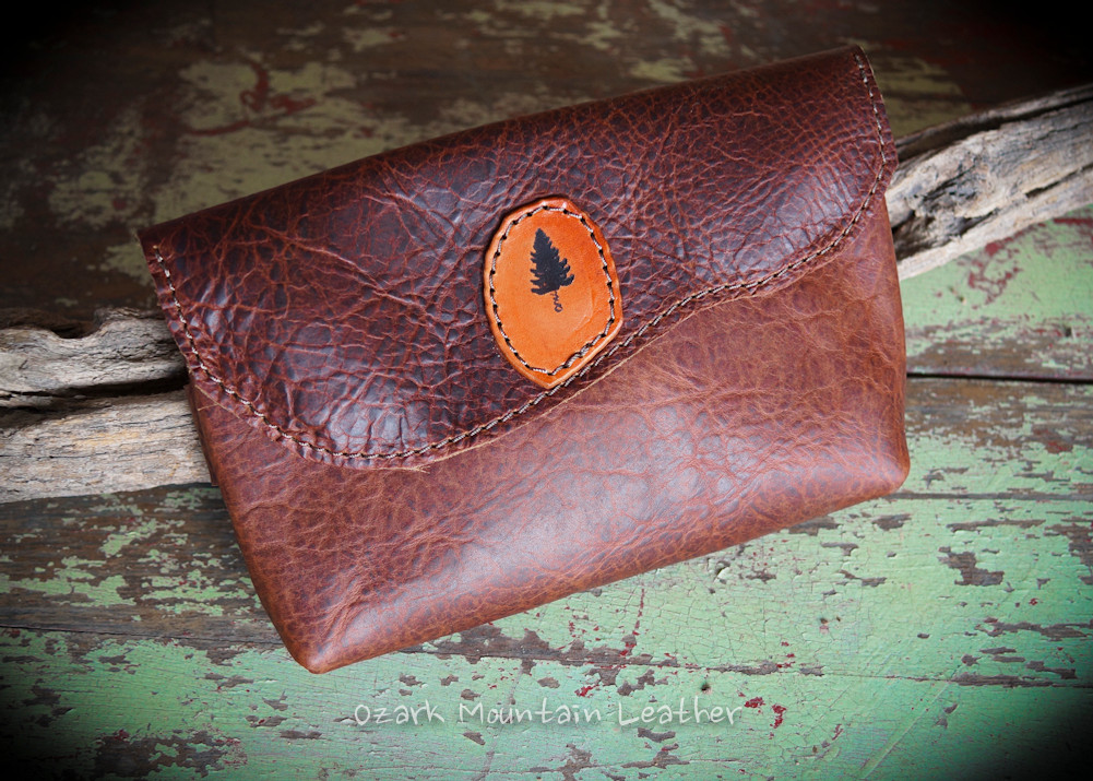 Bison leather clutch with hand strap.  Makes for easy carry and everyday use bag.  Leather bag makes the pefect accent to any outfit and would also make a great makeup bag to pair with one of our other leather bags.  Leather make up bag.