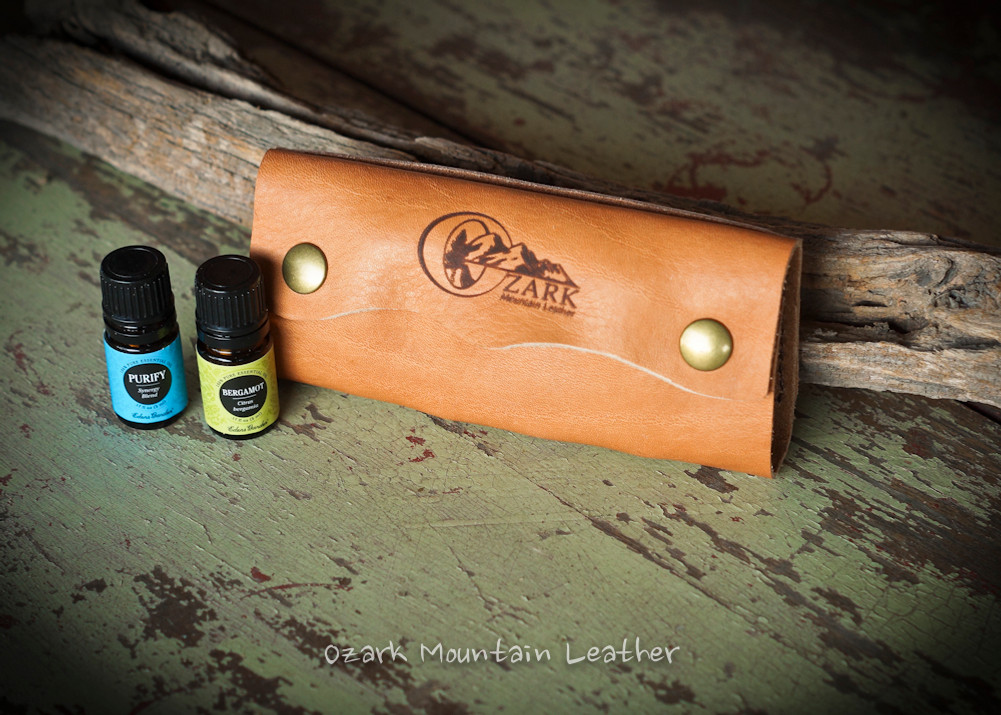 Essential oil pouch leather carrier travel case.  Keep oils safe in your bag by using this handy travel case or everyday use case.  Each oil slips down into the slots to be kept safe and secure.  Essential oil business card holder.  Essential oil leather case.  Essential oil travel case.