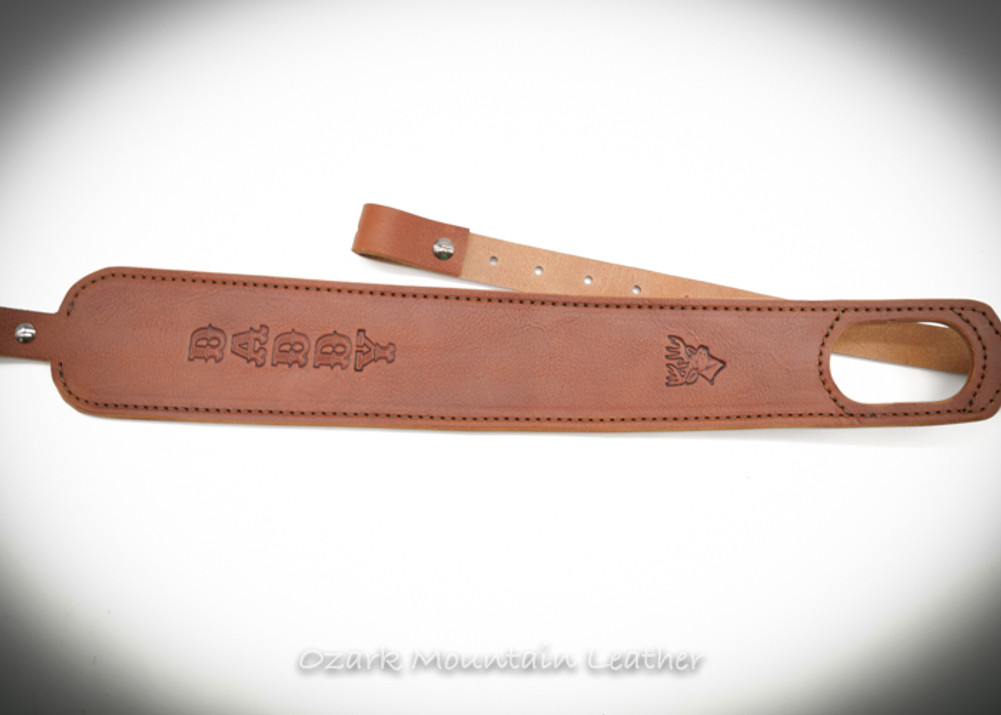 leather custom rifle sling with thumb-hole desing name or initials.  Makes great gift made in USA.