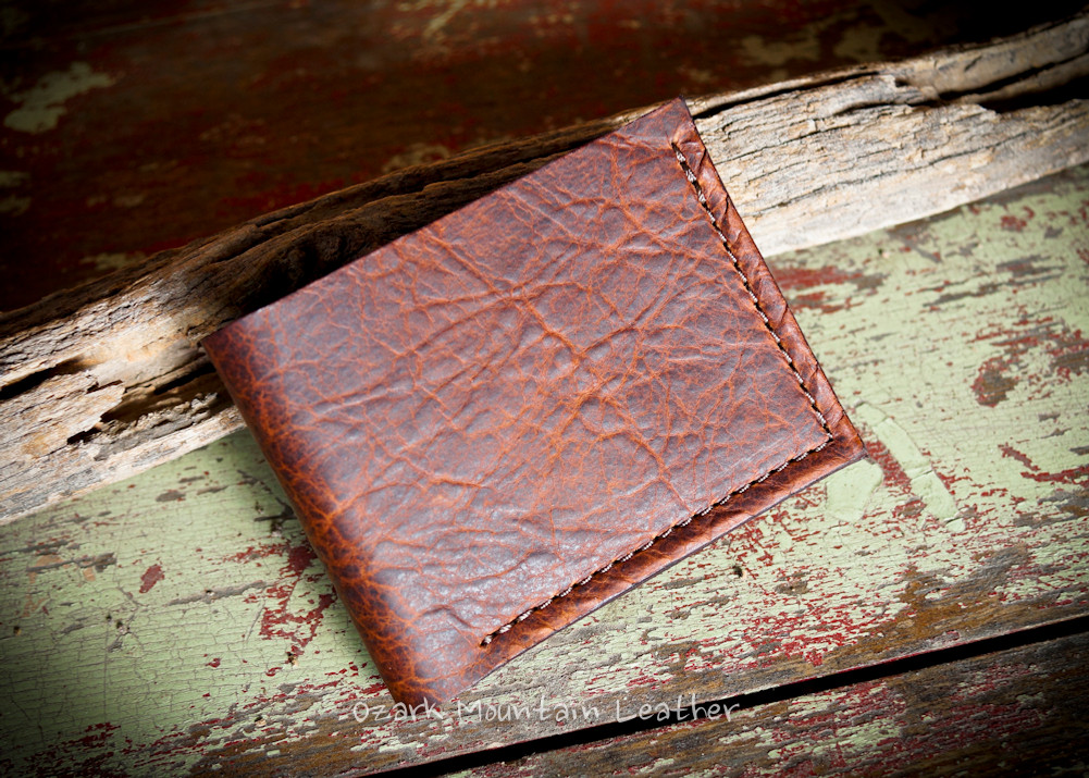 Bison leather billfold wallet in brown with 6 card slots.