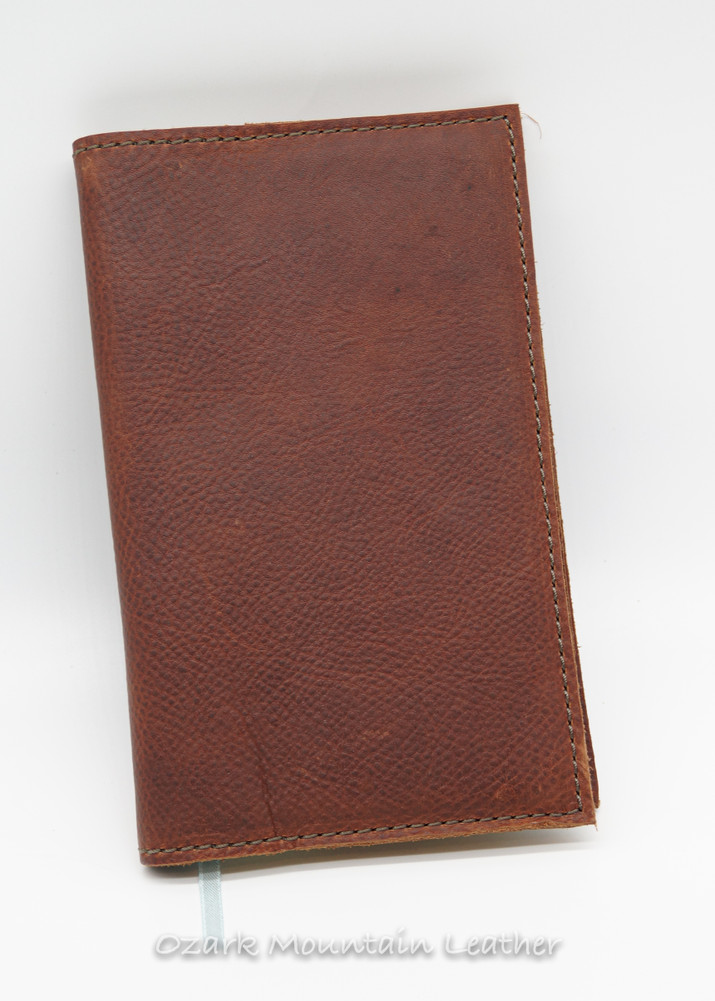 Brown leather journal cover with lined journal included.