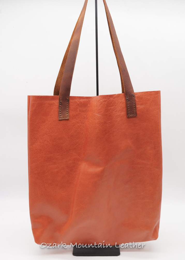 Salmon leather tote bag.
