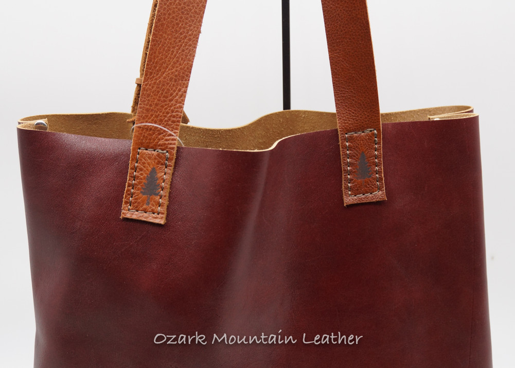 burgundy leather tote bag.