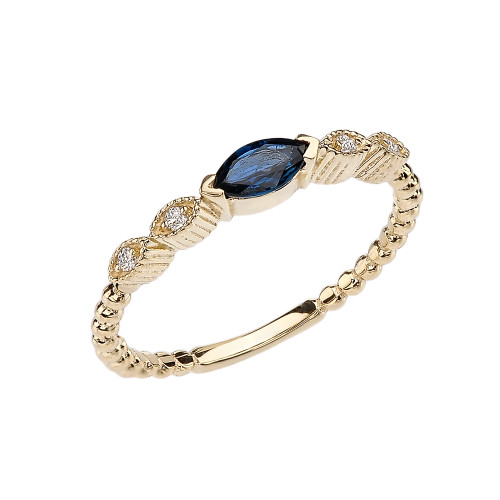 Sapphire and Diamond Marquise Cut Engagement/Proposal Beaded Ring in Yellow Gold