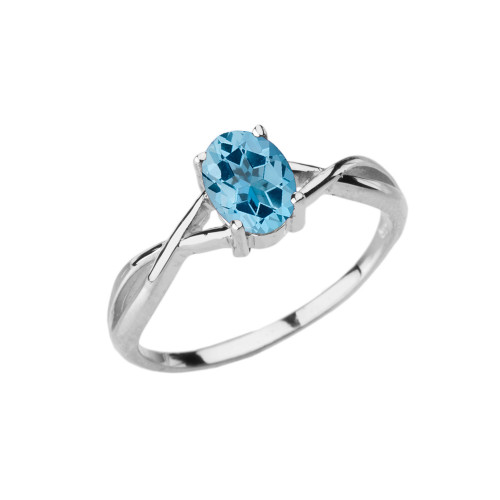 Dainty White Gold Infinity Design Blue Topaz (LCBT) Solitaire Ring