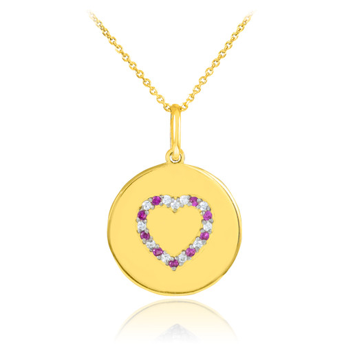 Heart disc pendant necklace with diamonds and rubies in 14k gold.