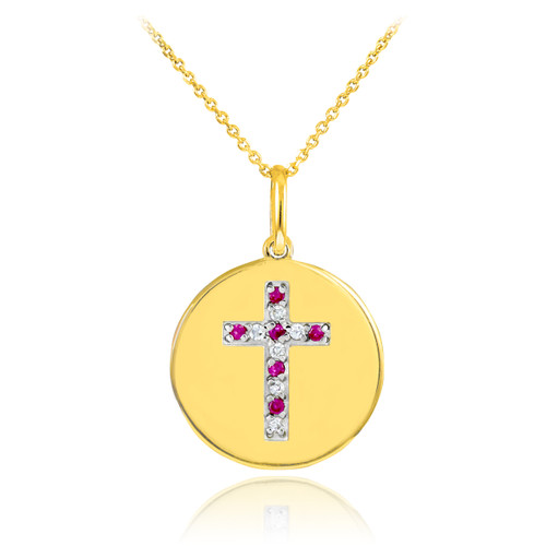 Cross disc pendant necklace with diamonds and rubies in 14k gold.