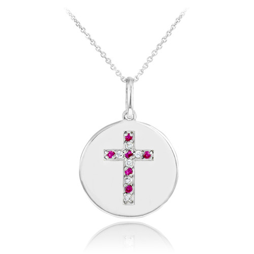 Cross disc pendant necklace with diamonds and rubies in 14k white gold.