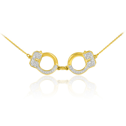 Handcuffs necklace with diamond accents in 14k yellow gold.