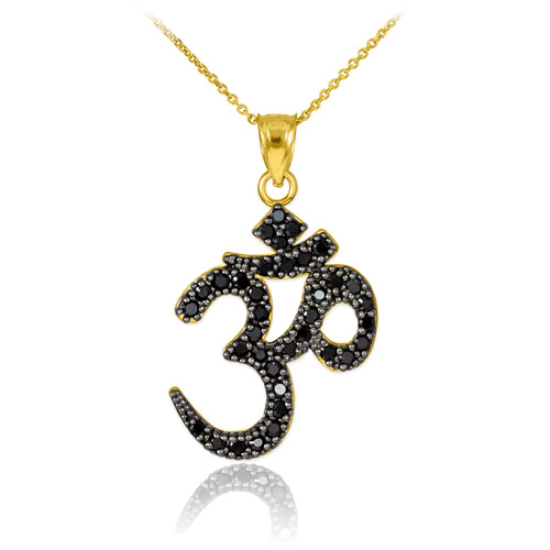 Black diamond Ohm/Om pendant necklace in 14k yellow gold.