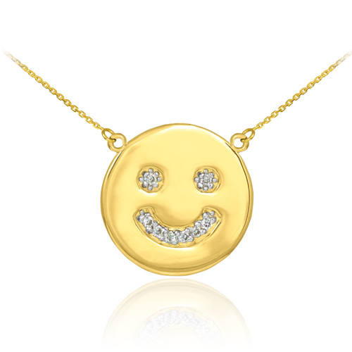 Smiley face disc necklace with diamonds in 14k yellow gold.