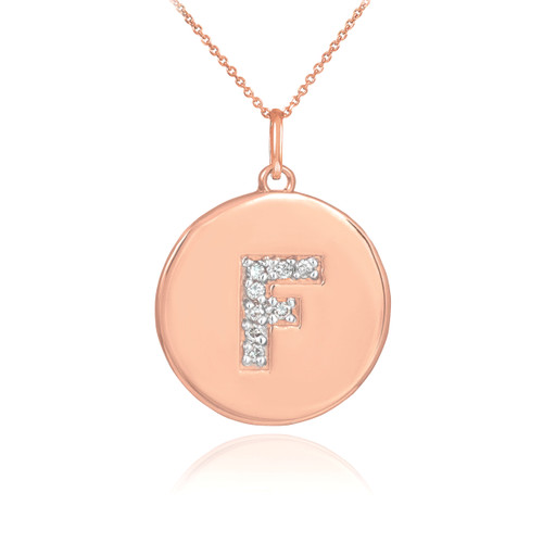 "Letter ""F"" disc pendant necklace with diamonds in 14k rose gold."