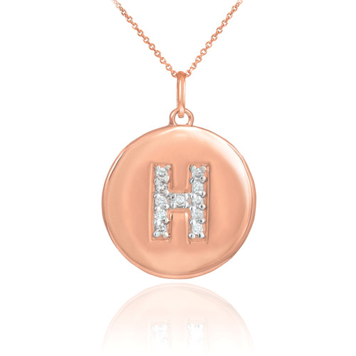 "Letter ""H"" disc pendant necklace with diamonds in 14k rose gold."